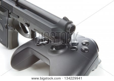Game Controller With Real Handgun Near It - Virtual And Real Life Concept