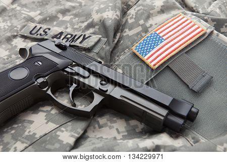 Handgun Over Usa Solder's Uniform With Shoulder Patch On It