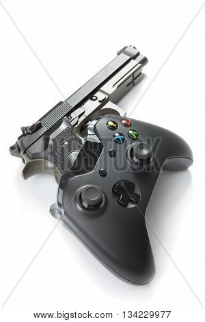 Virtual And Real Life Concept - Video Game Controller With Real Handgun Near It