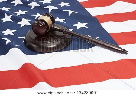 Close Up Shot Of A Judge Gavel Over Us Flag