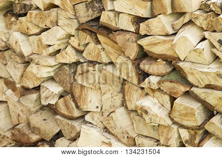 Fire wood cut up and stack, texture - background