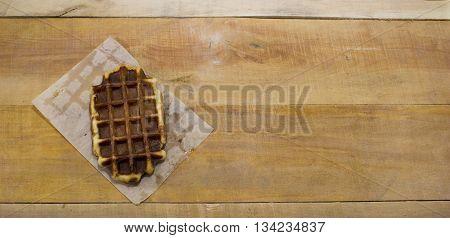 One belgian waffles lying on the desk.