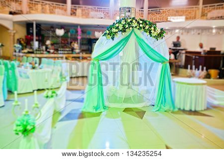 Wedding Decoration With Arch And Table On Restaurant