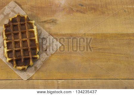 Sweet belgian waffles lying on the desk.