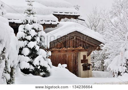 snowfall in a village with wooden cottage in Savoie - France