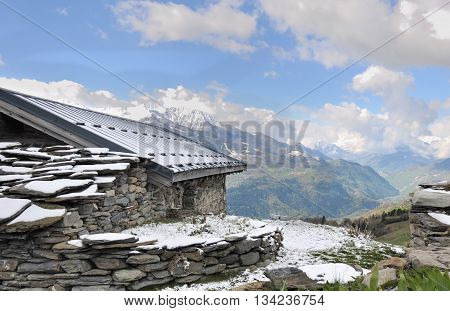 chalet in stone with panoramic view on mountain