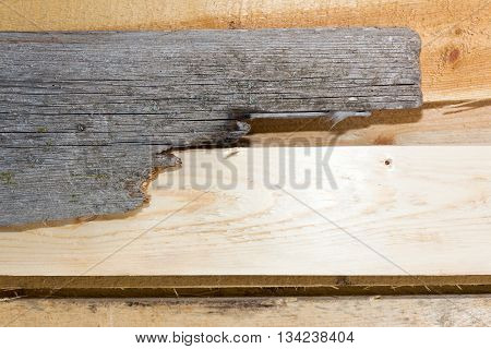 Board (plank) of wood. Old and cracked. The surface is rough and uneven.