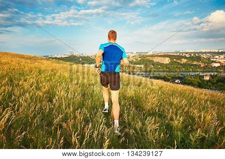 Athletic Runner On The Hillside