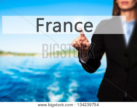 France - Businesswoman Hand Pressing Button On Touch Screen Interface.