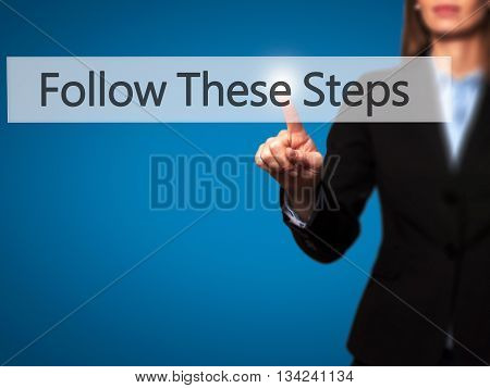 Follow These Steps - Businesswoman Hand Pressing Button On Touch Screen Interface.