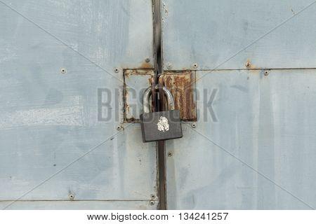 Old iron lock on the metal door