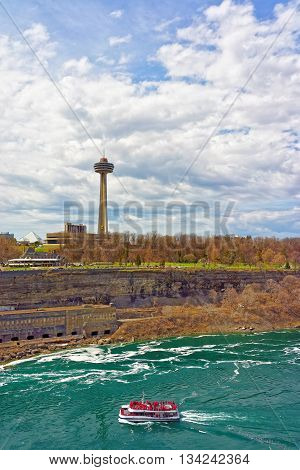 Niagara Falls, USA - April 29, 2015: Excursion Ferry in the Niagara River. Niagara River is a border between the United States of America and Canada.