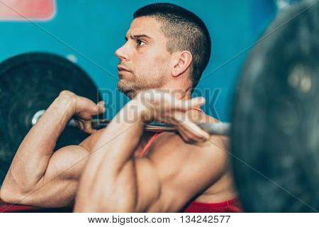 Weightlifting training, horizontal image, selective focus, indoors