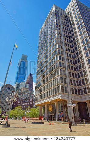 Philadelphia, USA - May 5, 2015: Municipal Services Building and skyscrapers in Philadelphia Pennsylvania the USA. It is central business district in Philadelphia. Tourists on the square.