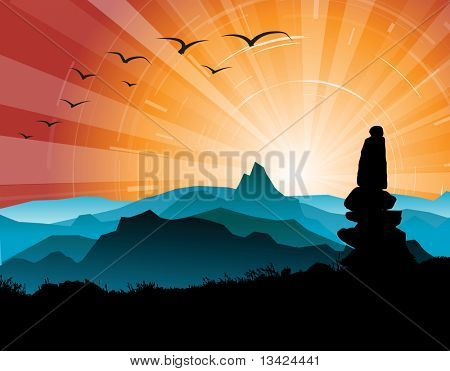 Silhouette of the stones, with mountains and sunset in the background