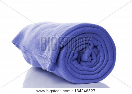 blue fleece blanket with reflection on white