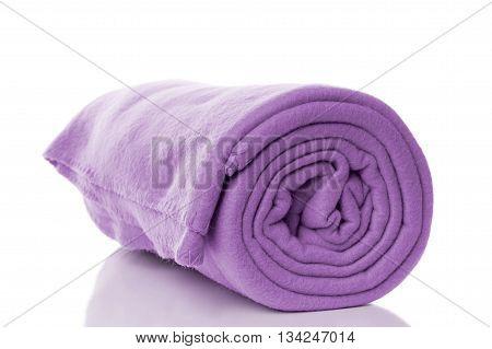 purple fleece blanket with reflection on white