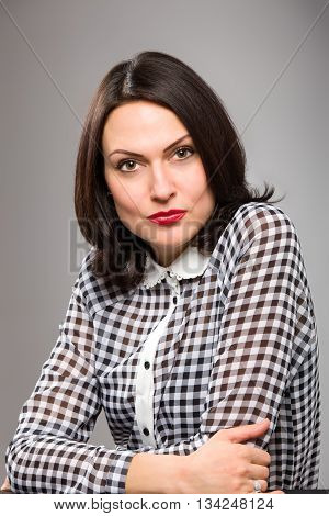 Portrait of happy young business woman isolated on grey background