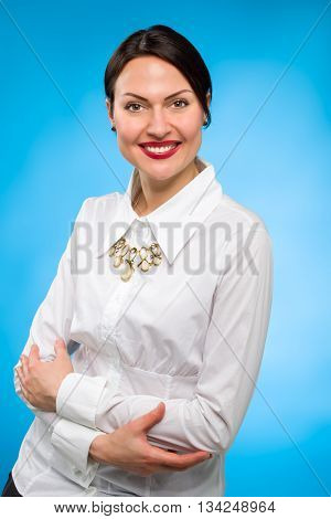 Portrait of happy young business woman isolated on blue background