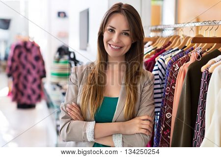 Woman standing in a clothing store