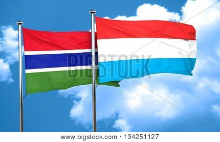 Gambia flag with Luxembourg flag, 3D rendering