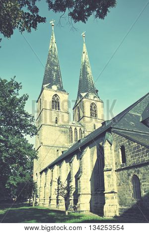 Church of Saint Nicholas (St. Nikolai-Kirche) in Quedlinburg, Germany. Retro style filtered image