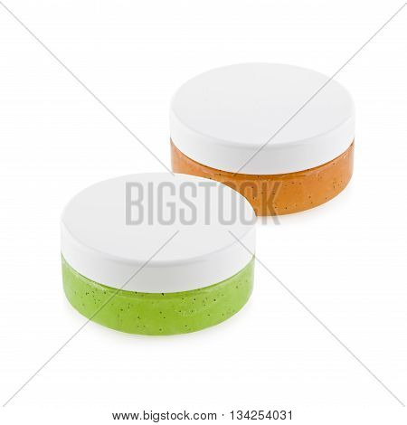 orange and green body scrub isolated on white background
