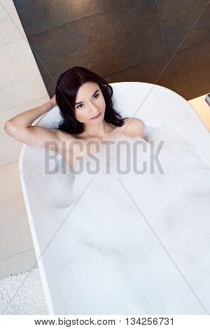 Woman Relaxing In Foamy Bath