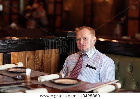 Man Poses In Restaurant