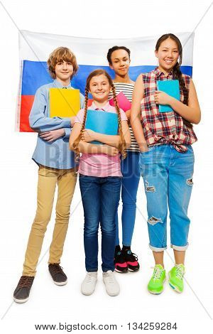 Whole-length picture of multi ethnic teenage students standing with textbooks with Russian flag on background, isolated on white