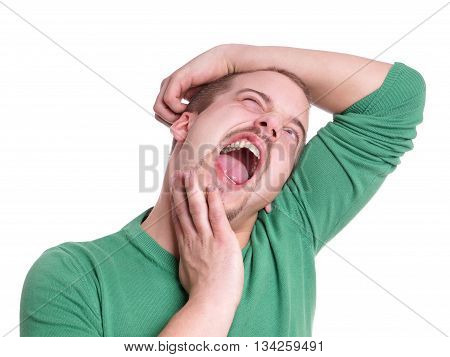 young man with crazy facial expression isolated on white