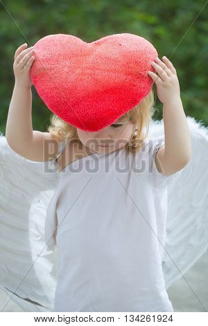 Small Boy In Angel Wings And Heart Pillow