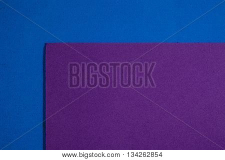 Eva foam ethylene vinyl acetate smooth purple surface on blue sponge plush background