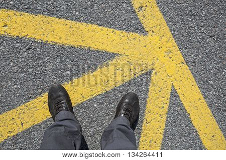 Male Feet In Leather Shoes Stand On On Asphalt