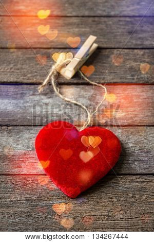 Red hearts with bokeh on wooden background vertical