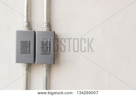 modern Light switch on background concrete wall.