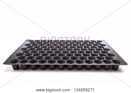 Black Empty Plastic Tray With Hole For Seedlings Isolated On White