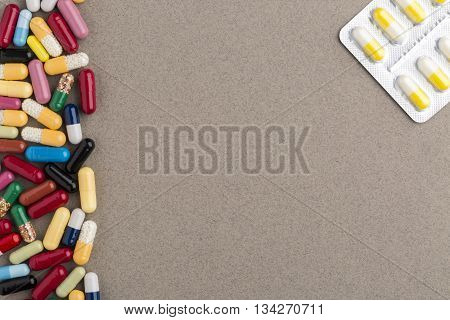 Decorate border from various colorful capsules and pill blister pack