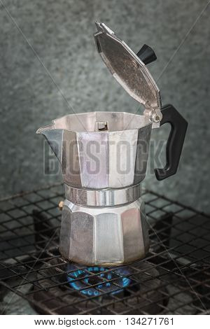 background italian Percolator steaming in the morning.