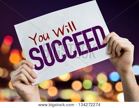 You Will Succeed placard with night lights on background