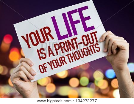 You Life is a Print-Out Of Your Thoughts placard with night lights on background