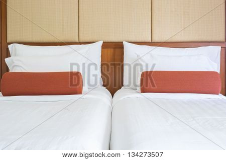 White Bedding Sheets And Pillow In Hotel Room