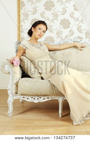 Lady in evening gown on royal sofa