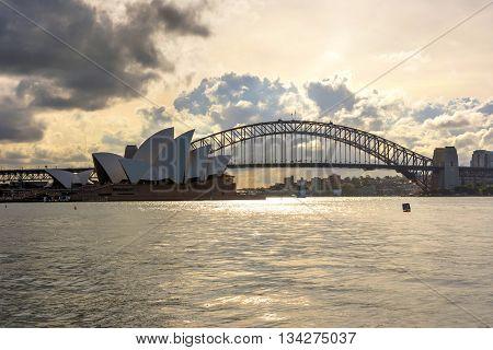 SYDNEY, AUSTRALIA - APRIL 18: View on Sydney Opera house and harbour bridge at day time, most recognizable city's landmarks. April 2016