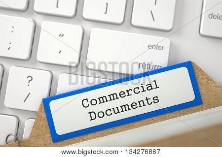 Commercial Documents Concept. Word on Blue Folder Register of Card Index. Blue Card Index on Background of White PC Keypad. Closeup View. Blurred Illustration. 3D Rendering.