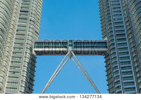 KUALA LUMPUR MALAYSIA - FEBRUARY 29: Close up view of skybridge of Petronas Twin Towers on February 29 2016 in Kuala Lumpur Malaysia. A skybridge connects the two towers.