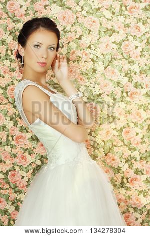 Young fiancee - glamour beauty on floral background