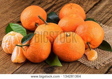 Mandarins Tangerines fruits  decorated on jute background.