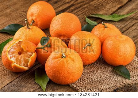Juicy Tangerines on wooden table. Fresh Tangerines on rustic background.