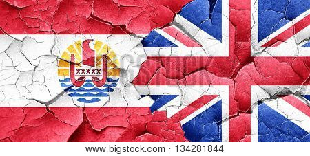french polynesia flag with Great Britain flag on a grunge cracke